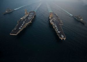 Flickr_-_Official_U.S._Navy_Imagery_-_USS_Enterprise,_USS_Dwight_D._Eisenhower,_USS_Vicksburg_and_USS_Hue_City_are_underway_in_formation.