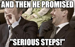 Putin-laughing-at-serious-steps-meme